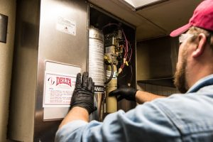 Delta Fire Technician working on Wet Chemical source for a kitchen hood.